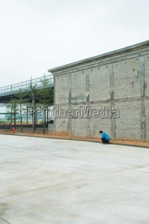 urban scene person crouching next to