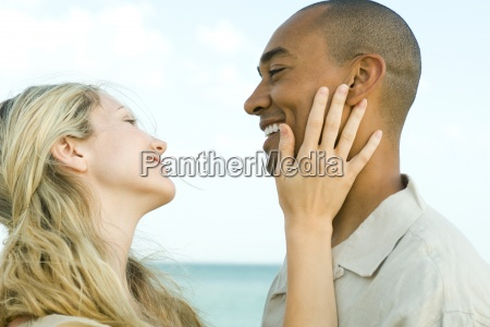 couple smiling at each other womans