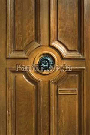 wooden door with ornate knob cropped