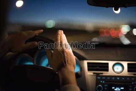 driver drumming hands on steering wheel