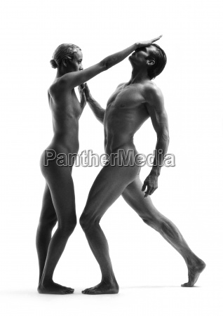 nude man and woman standing face