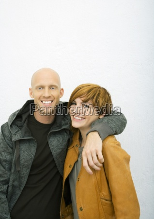 young couple man with arm around