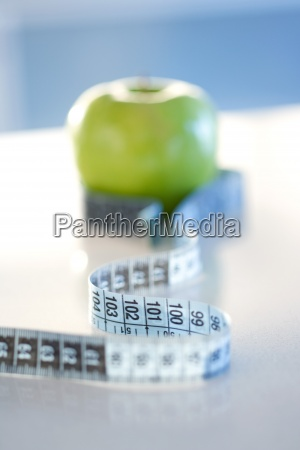 measuring, tape, wrapped, around, green, apple, - 16631970