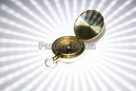 brass compass close up