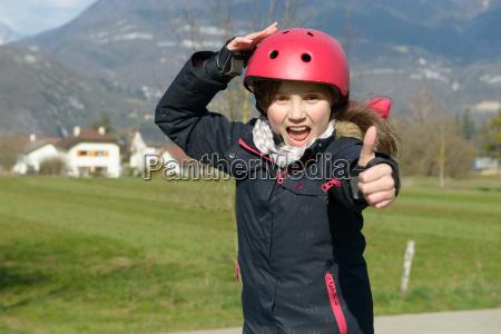 teenage girl wearing a roller helmet
