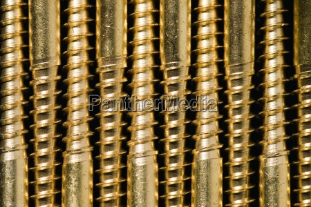 screws lined up extreme close up