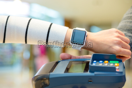 customer using smartwatch to pay the