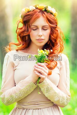 romantic girl with wild flowers