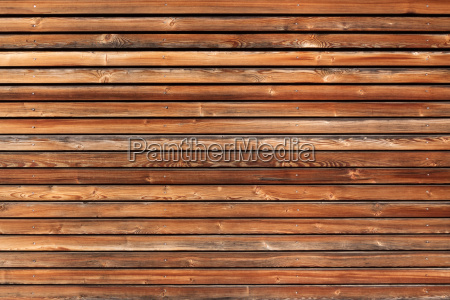 brown horizontal board wall with four