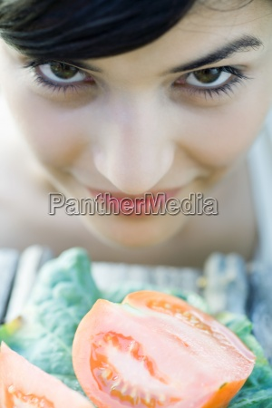 young woman leaning face over cut