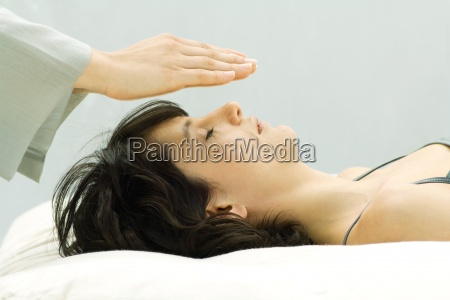 woman undergoing alternative therapy treatment therapists