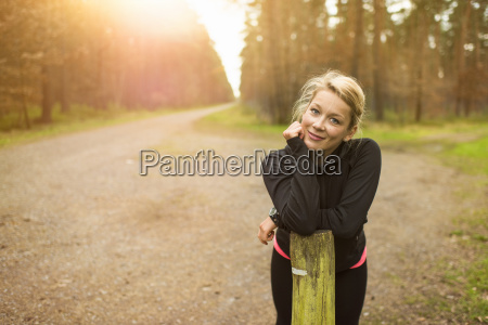blonde woman on dirt road in