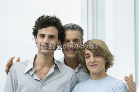 mature father and two sons portrait