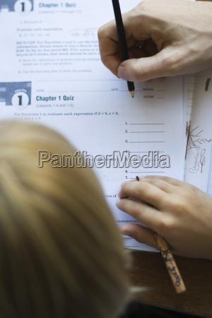student watching as teacher grades quiz