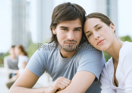young couple in urban park woman