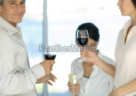 mature group of friends drinking wine