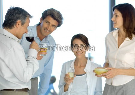 mature group of friends having before