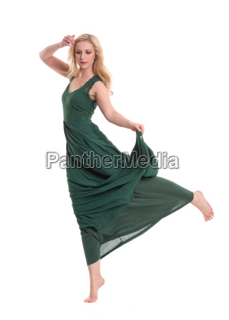beautiful blond woman in long green