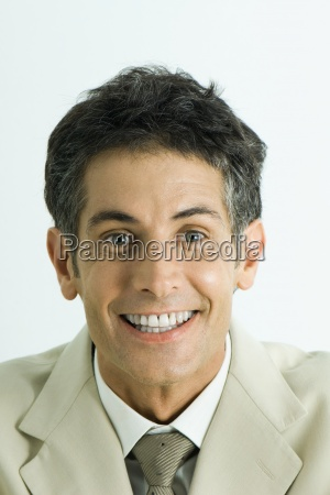 man looking at camera with toothy