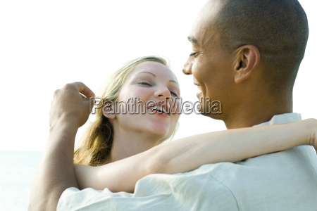 couple embracing and smiling at each