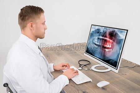 doctor looking at teeth x ray