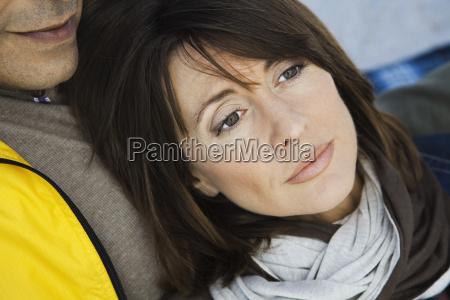 mature woman resting head on husbands