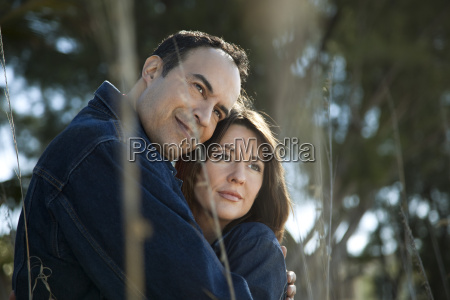 mature couple embracing outdoors portrait