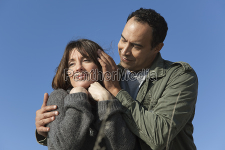 mature couple relaxing together outdoors man