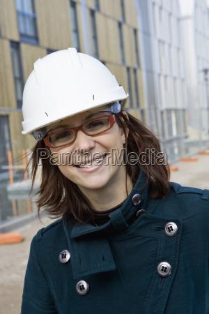 female architect in hard hat portrait