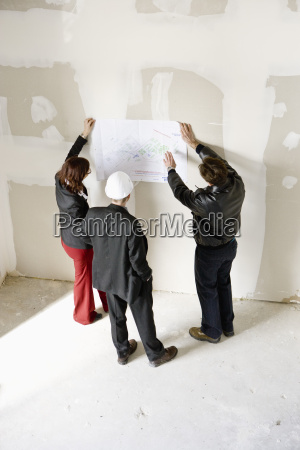 property developers discussing blueprint