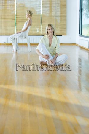 group meditation woman sitting on floor