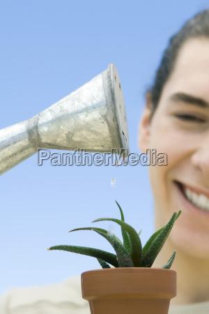 man watering plant