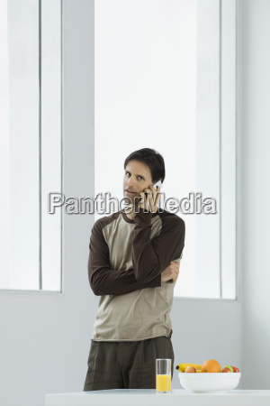 man talking on cell phone looking