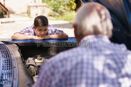 boy with grandpa learning car engines