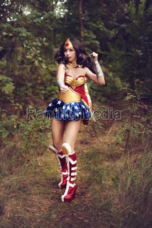 woman wearing super hero costume