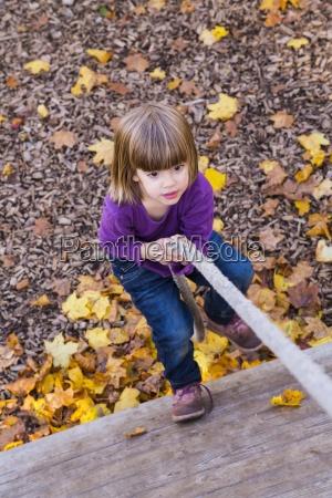 little girl climbing upwards