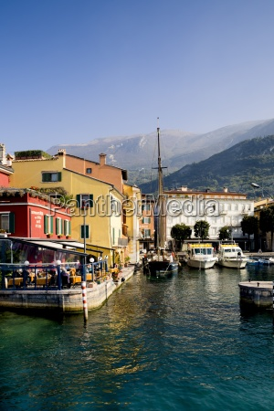 italy veneto malcesine harbour with sailing