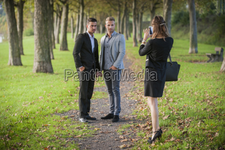 young businesswoman photographing business partners