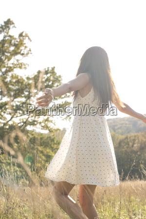 young woman wearing summer dress enjoying