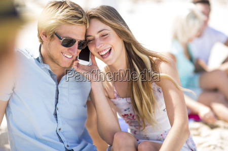 young woman and man interacting with