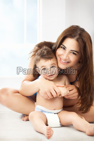 cheerful mother with little son