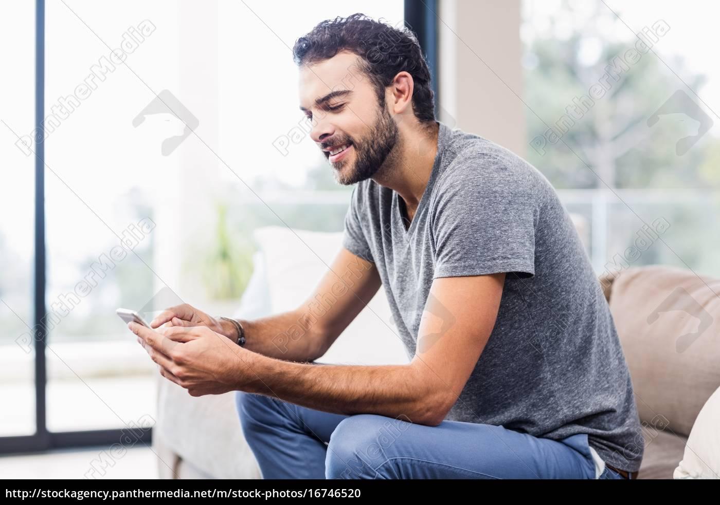 handsome, smiling, man, using, smartphone - 16746520