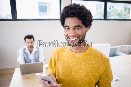 smiling man using smartphone with partner