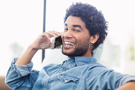 handsome smiling man on phone call