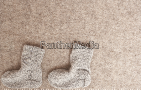 babys woolen socks on blanket