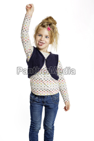 blond little girl making faces in