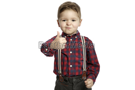 little boy with thumb up wearing
