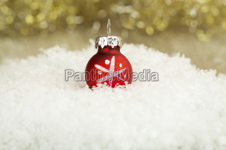 christmas bauble on artifical snow