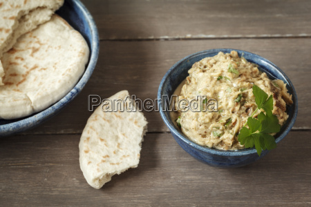 bowl of baba ghanoush with flat
