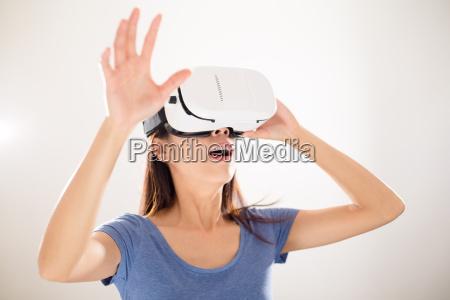 asian woman wearing virtual reality device